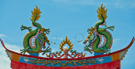 Dragon on top of temple roof - Traditional Chinese temple roof