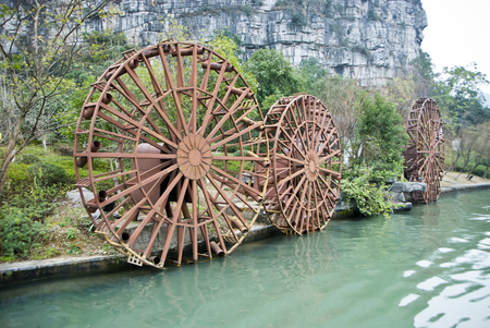 Water mill and wooden water wheel at Guilin Village, China Stock Photo