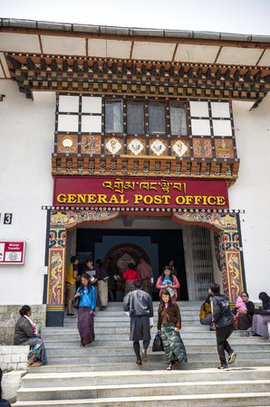 High volume of people visiting the busy General Post Office building at capital city Thimpu Royal Govt of Bhutan for postal transaction. Visitor can have their own image printed into their postal stamp.