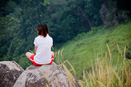 meditation mountain top - Young girl meditate on the top of mountain in sunrise time