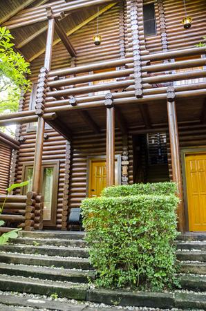 Log house - Cozy log house amongst green environment.