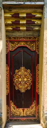 door handle: Traditional Balinese wood carved door Stock Photo