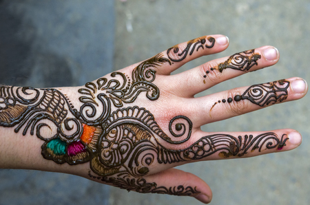 henna painted hand decorations