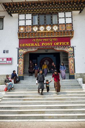 Large volume of people visiting the busy General Post Office building at capital city Thimpu Royal Govt of Bhutan for postal transaction, Thimphu, Bhutan Editorial