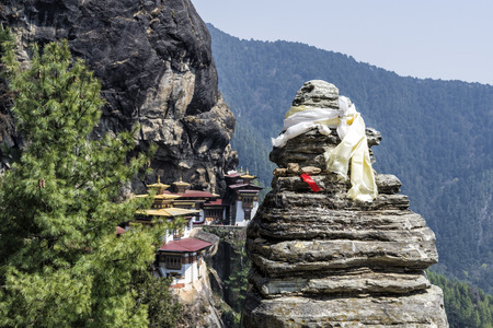 purposely: View Point of Taktshang monastery, Bhutan. Tigers Nest Monastery also know as Taktsang Palphug Monastery. This image is purposely blurred out the blackgroud to bring focus on the prayer stone.