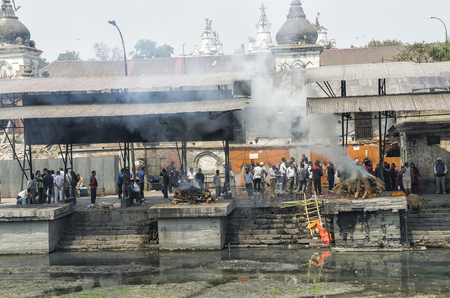 The cremation ceremony along the holy Bagmati River in Bhasmeshvar Ghat at Pashupatinath temple in Kathmandu, Nepal Editorial