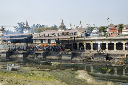 The cremation ceremony along the holy Bagmati River in Bhasmeshvar Ghat at Pashupatinath temple in Kathmandu.