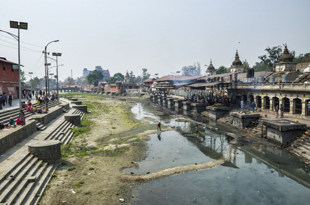 The cremation ceremony along the holy Bagmati River in Bhasmeshvar Ghat at Pashupatinath temple in Kathmandu, Nepal.