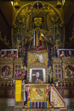 Great statues of lord buddha and monks inside buddhism monastery temple near Boudhanath Stupa, Kathmandu, Nepal. Editorial