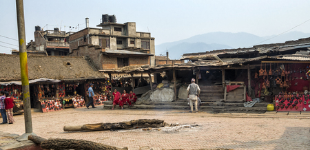 Kathmandu, Nepal - 13 April, 2016: Unidentified vistors and tourists around the street in Bhaktapur after major earthquake in 2015 and reconstruction is still on going. Editorial