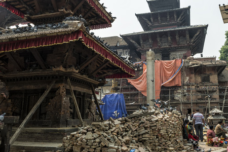 Kathmandu, Nepal - 13 April, 2016: Damages of street and building in Bhaktapur after major earthquake in 2015 and reconstruction is on going.