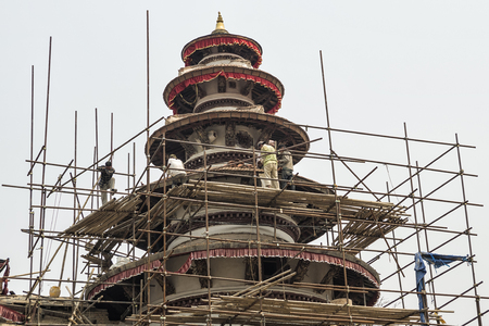Kathmandu, Nepal - April 13, 2016: Basantapur Durbar after major earthquake in 2015 and reconstruction is on going, Kathmandu Durbar Square, Nepal. Basantapur Durbar also called Nau-talle Durbar was built by King Prithvi Narayan Shah in 1770.