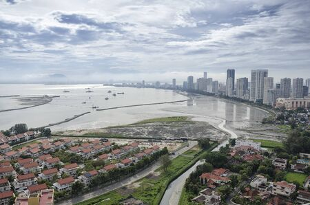 Scenic view of Gurney Drive with land reclamation activities, Penang, Malaysia. Gurney Drive is a popular seafront promenade within George Town, Penang, Malaysia