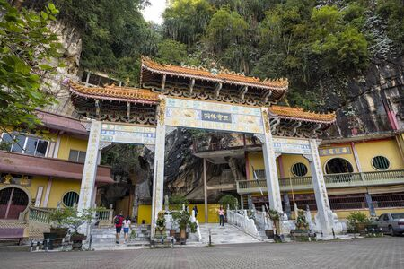 Unidentified visitors and the enterance of Sam Poh Tong, Ipoh, Malaysia