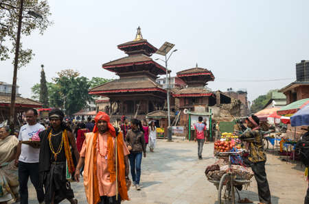 Busy Asan Tole Market with workers, local and tourists, Indra Chowk, Kathmandu Nepal. Indra Chok is one of the ceremonial and market squares on the artery passing through the historic section of Kathmandu, Nepal.The intersection of Indra Chok, along with