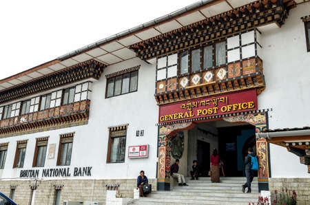 The busy and famous General Post Office and National Bhutan Bank building at capital city Thimpu Royal Govt of Bhutan for postal transaction. Visitor can have their own image printed into their postal stamp