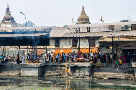Cremation ceremony along the holy Bagmati River at Pashupatinath Temple, Kathmandu, Nepal. Sri Pashupatinath Temple located on the banks of the Bagmati River and is one of the most significant Hindu temples in Nepal