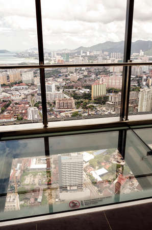 Observatory Deck with transparent glass floor at level 68 on roof top of Komtar Tower, Penang. Malaysia. Komtar Penang is a 65-storey high rise tower in central Georgetown that is one of the most prominent landmarks in Penang. Editorial