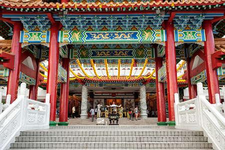 Thean Hou Temple with unidentified prayers, Kuala Lumpur, Malaysia. The Thean Hou Temple is a landmark six-tiered Chinese temple in Kuala Lumpur.