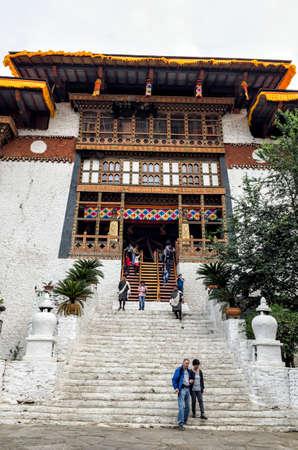 Visitors and the enterance of Punakha Dzong or Pungthang Dewachen Phodrang monastery, Punakha, Bhutan. Editorial