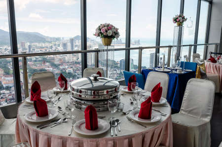 Indoor restaurant over looking Georgetown city from the 66th Floor of the Komtar tower, Penang, Malaysia. Komtar Penang is a 65-storey high rise tower in central Georgetown that is one of the most prominent landmarks in Penang.