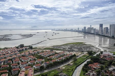 Scenic view of Gurney Drive with land reclamation activities, Penang, Malaysia