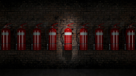 Brandblusser vast op bakstenen muur Stockfoto