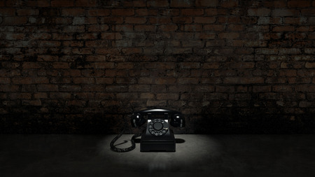 Old black telephone on brick wall photo