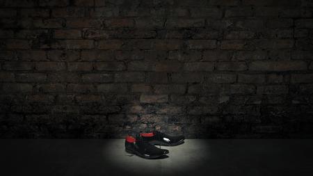 black shoes and bricks wall