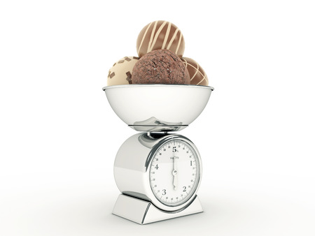 kitchen scale with chocolates photo