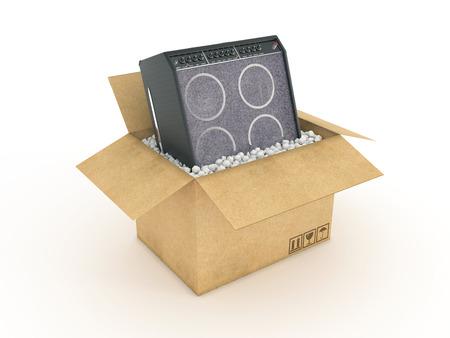 guitar amplifier: Electric guitar amplifier in cardboard box