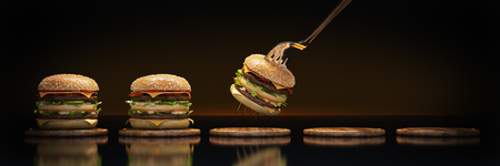A small hamburger stuck in the fork. The concept of adequate nutrition. 3d render 版權商用圖片