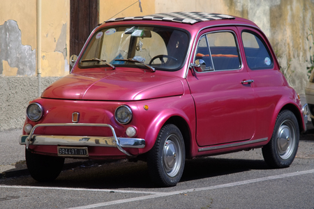 Pink violet outdoor model parked in the city. Fiat 500 last century vintage car. 1950 1960 1970 1980 1990 Tuscany Italy Europe Redakční