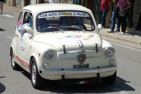 White outdoor model ready for a local race competition. Fiat 500 last century vintage car. 1950 1960 1970 1980 1990 Tuscany Italy Europe