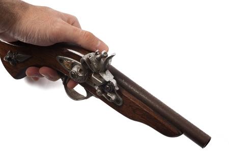 flint gun: a wooden ancient gun isolated on a white background