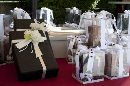 favors on a table outdoor with boxes for wedding