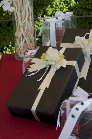 favors on a table outdoor with boxes for wedding photo
