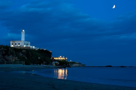 a night view of anzios lighthouse with clouds