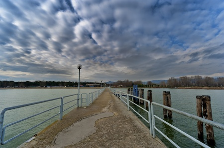 dock on trasimeno lake river used by ferryboats