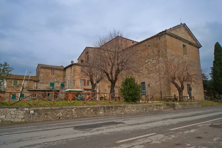 ancient stone church on trasimeno lakes river
