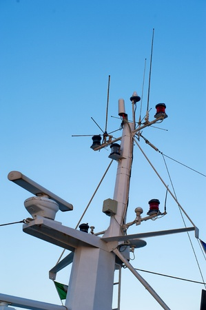 radio tower with antennas and lights of a boat