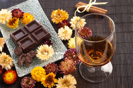 traditional cuban rum and chocolate composition with flowers  Stock Photo