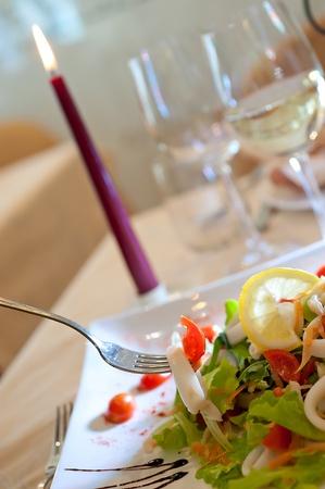 sailor salad with raw shellfishes and tomato