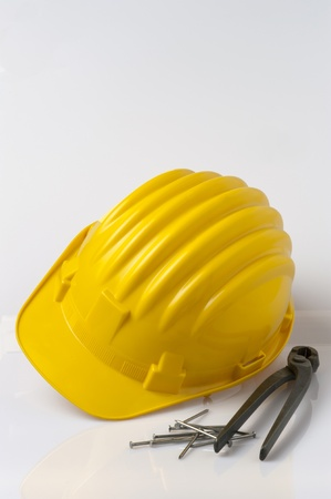 helmet, pincers and pin isolated on white background