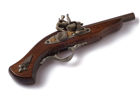 a wooden ancient gun isolated on a white background photo