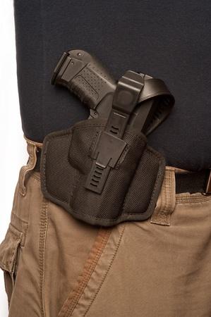 man wearing uniform with gun hanging to belt Stock Photo - 9584461