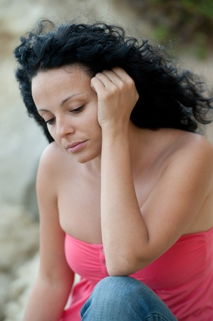 a young cute european brunette girl depressed outdoor  Stock Photo - 9789352