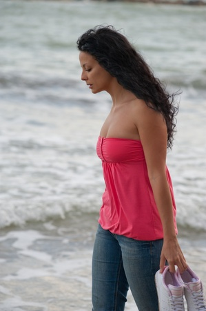 a young brunette european girl walking in the water Stock Photo - 9789273