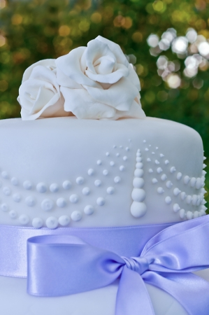 tiered: details on a wedding cake with violet ribbons and decorations Stock Photo