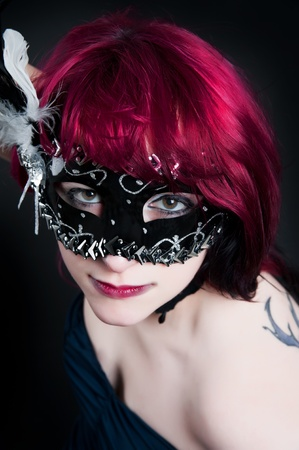 a young seductive redheaded girl on a black background